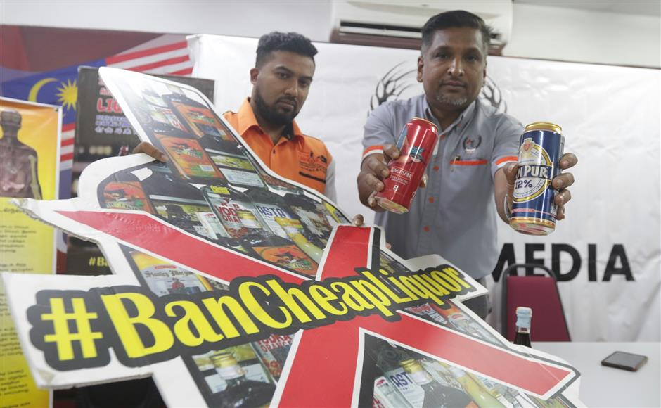 (BRIEF CAPTION) Malaysian Anti-Cheap Liquor Movement president P.David Marshel (right) showing two of the cheap liquor sold in the market during the press confrence at his service center in Chai Leng Park in Buttrworth,Penang. Pic by: ZHAFARAN NASIB/The Star/ 19 September 2018