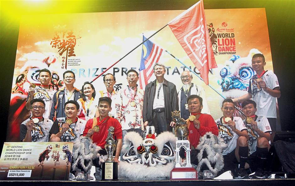 Champion Kun Seng Keng Lion and Dragon Association Muar, Johor posing with the champions and challenge trophy. — Photos: M. AZHAR ARIF/The Star