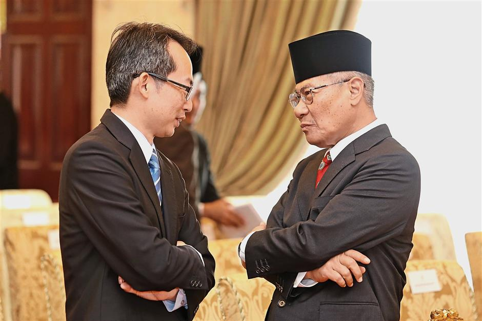 Law (left) and Nibong Tebal MP Datuk Mansor Othman having a chat during the swearing-in ceremony.