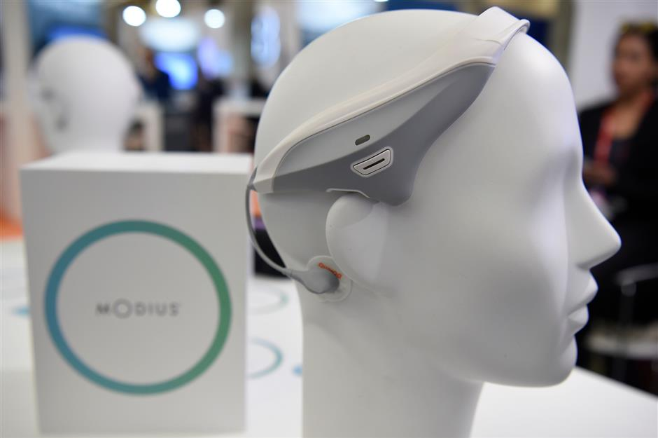 Picture taken of a Modius headset device that stimulates the part of the brain known to control fat storage, metabolism and appetite at the Mobile World Congress (MWC), the world's biggest mobile fair, on February 26, 2018 in Barcelona. the Mobile World Congress is held in Barcelona from February 26 to March 1.  / AFP PHOTO / Josep LAGO