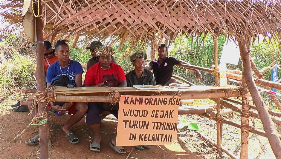 Under threat: The Temiars have had to put up blockades near Gua Musang to ensure their ancestral lands are not encroached as far back as 2012.