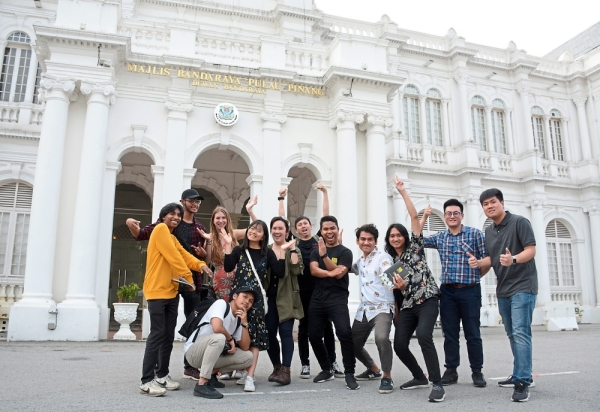 Local and international finalists of the When Night Falls open call for projection mapping, posing for the cameras in front of the City Hall building which they would later bring alive with a series of 30-second videos. (Jeremy Tan / July 13, 2019)