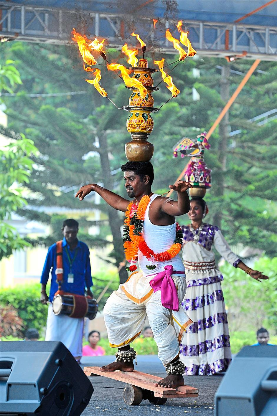 Easy does it: A Karagatam dancer balancing 'claypots of fire' on his head during the event.