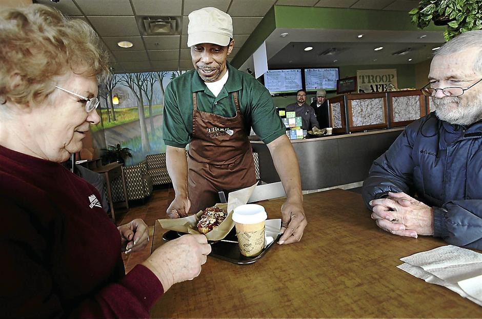 Hakim Clark served in the Army and began training at the cafe recently.