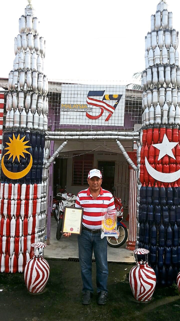 Putting to good use: Khamis uses recyclables to build the replicas at his home.