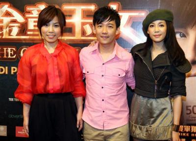 Ladies man: The Golden Couple movie is helmed by Malaysian director Aniu (centre), who is pictured here, flanked by Malaysian singer Jess Lee (left) and Singaporean actress Fiona Xie.