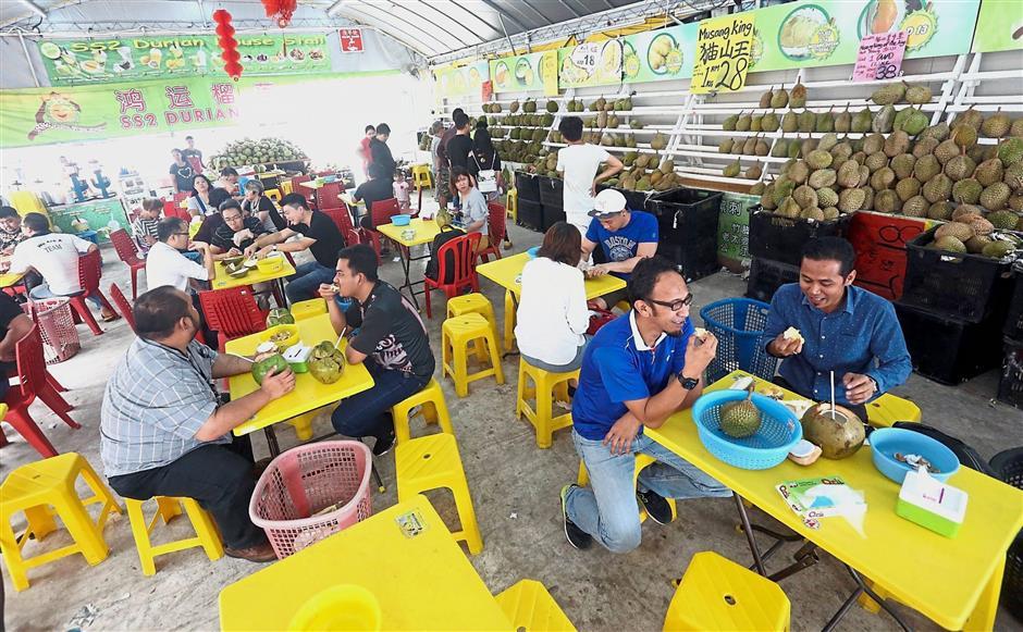 Customers enjoying durian at a stall in SS2, Petaling Jaya.