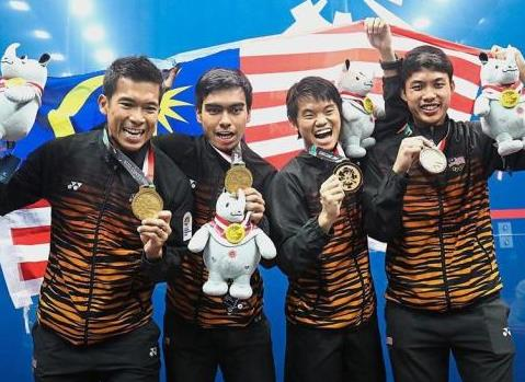 Malaysia men squash team celebrate after beat Hong Kong in the mens team final match during Asian Games 2018 in Squash Stadium Gelora Bung Karno, Jakarta, Indonesia. FAIHAN GHANI/The Star.