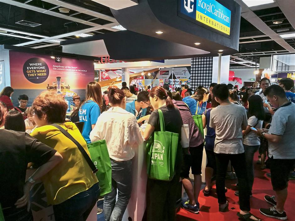 Cruise lovers crowding the Royal Caribbean Cruise booth, where promotions included special deals for its cruise liner 'Symphony of the Seas'.