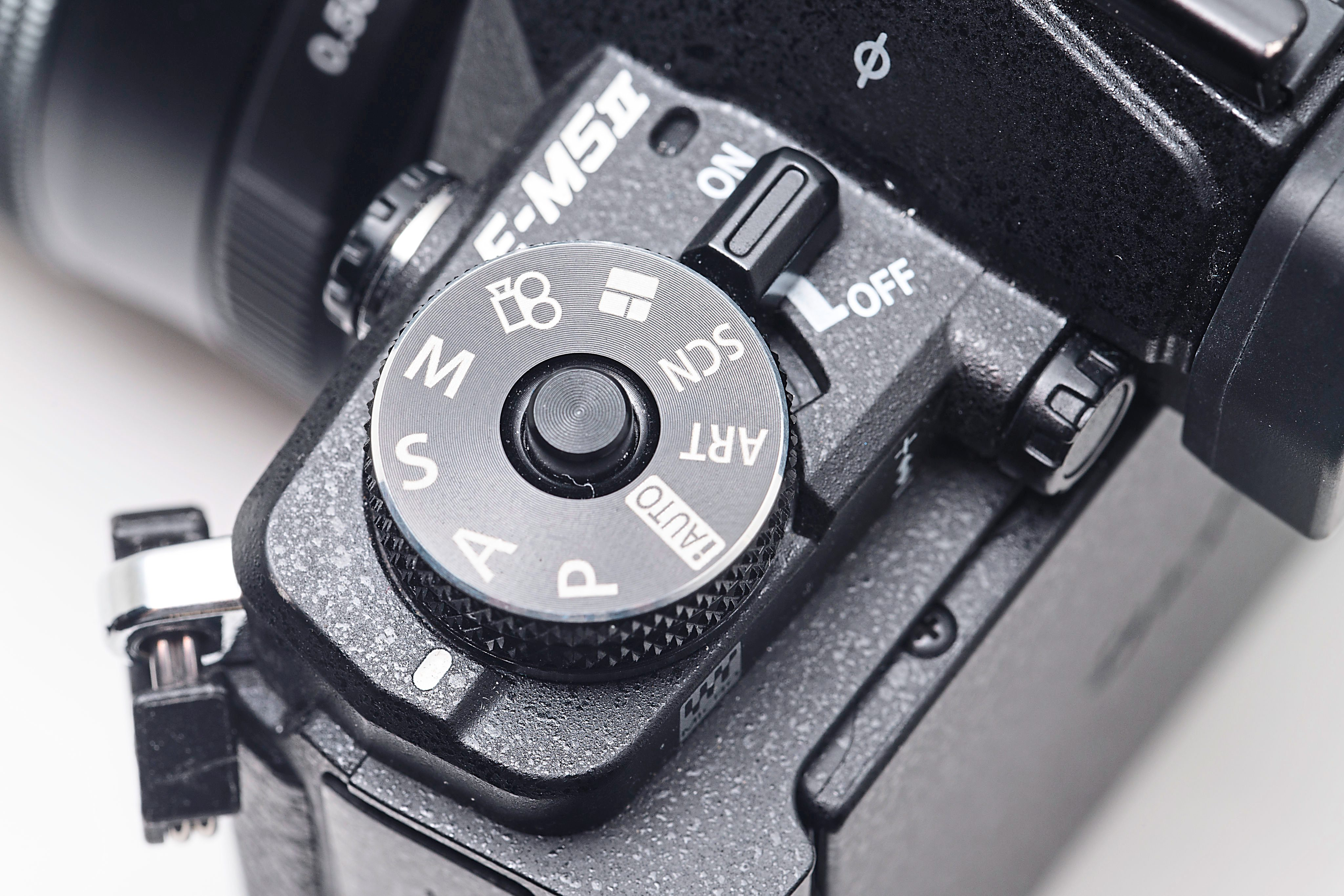 Lock: the mode dial on the OM-D E-M5 Mark II can be locked down to prevent accidentally moving out of the set mode by pressing the button in the centre of the dial.