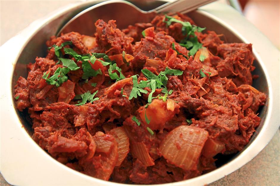 Lamb Bhuna: Boneless lamb pieces prepared in a dry-fried sauce.