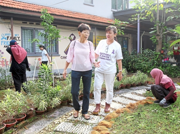 Dr Loh (right) and Wong at the KeepAble Cancer Community Centre garden in Petaling Jaya.