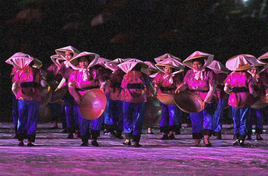 A colourful performance depicting the era of tin mining during the opening ceremony.