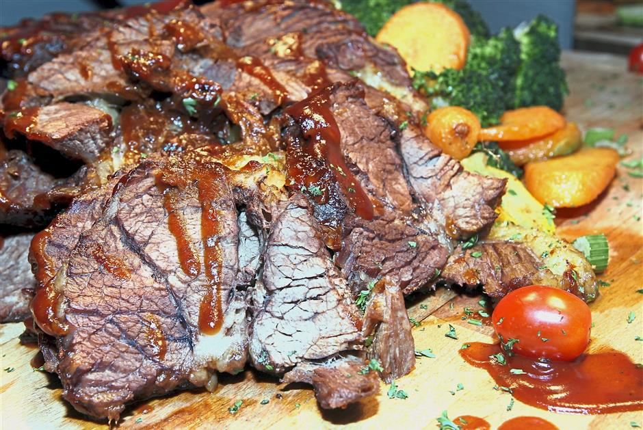 The flavourful Barbecued Beef Brisket is slow braised in orange, Roma tomatoes and chilli sauce for six hours before barbecuing.