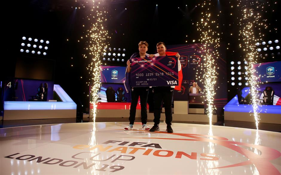 Esports - The FIFA eNations Cup - Maidstone, Kent, Britain - April 14, 2019   Corentin \'MAESTRO\' Thullier and Lucas \'DaXe\' Cuillerier of France pose as they celebrate winning the FIFA eNations Cup   REUTERS/Tom Jacobs