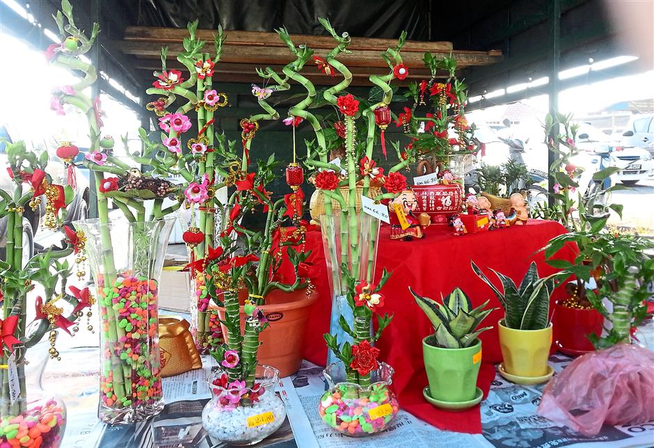 All in one: Some Chinese New Year plants are already decorated with different ornaments for the shoppers' convenience.