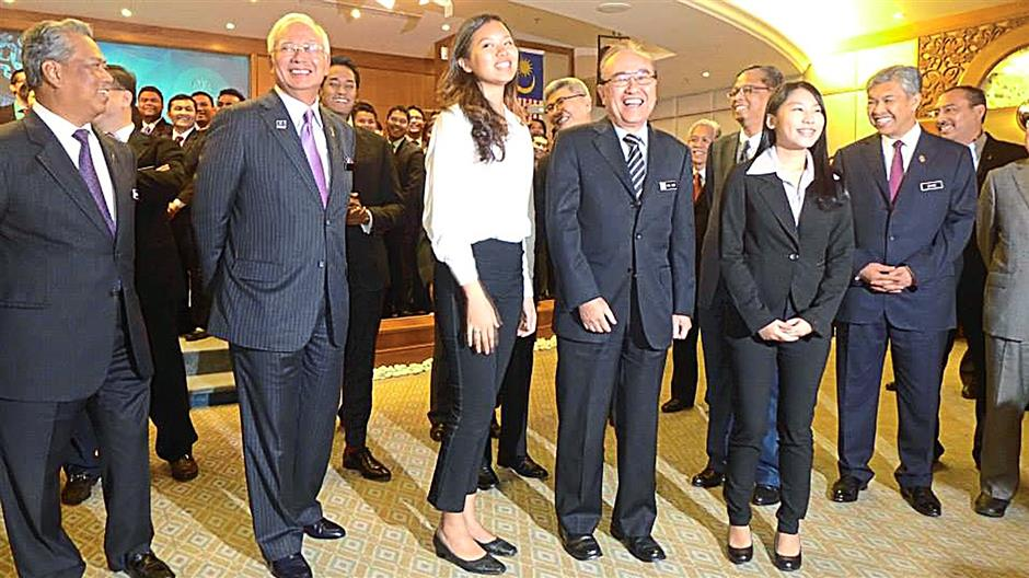 Perdana Fellow Victoria Cheng (third from left), 22, during the Perdana Fellows Programme handover ceremony, where she was assigned to Minister in the Prime Minister's Department Datuk Paul Low.