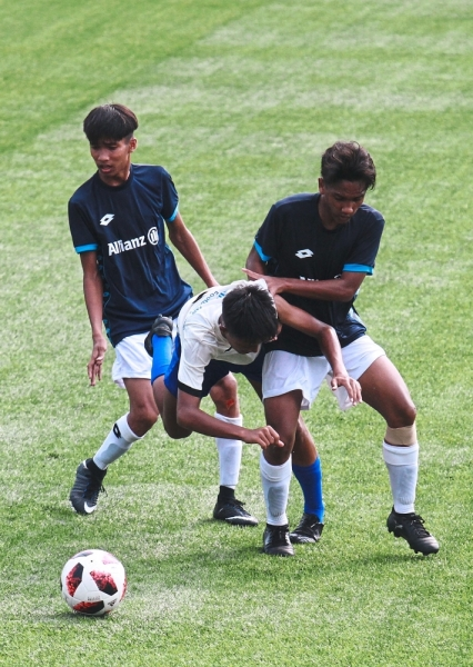 The East Coast boys (in blue) scored two early goals in the first half to leave their opponents with a mountain to climb.