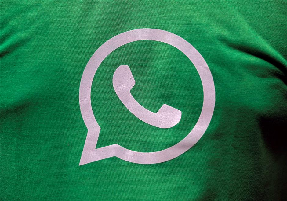 A logo of WhatsApp is pictured on a T-shirt worn by a WhatsApp-Reliance Jio representative during a drive by the two companies to educate users, on the outskirts of Kolkata, India, October 9, 2018. Picture taken October 9, 2018. REUTERS/Rupak De Chowdhuri