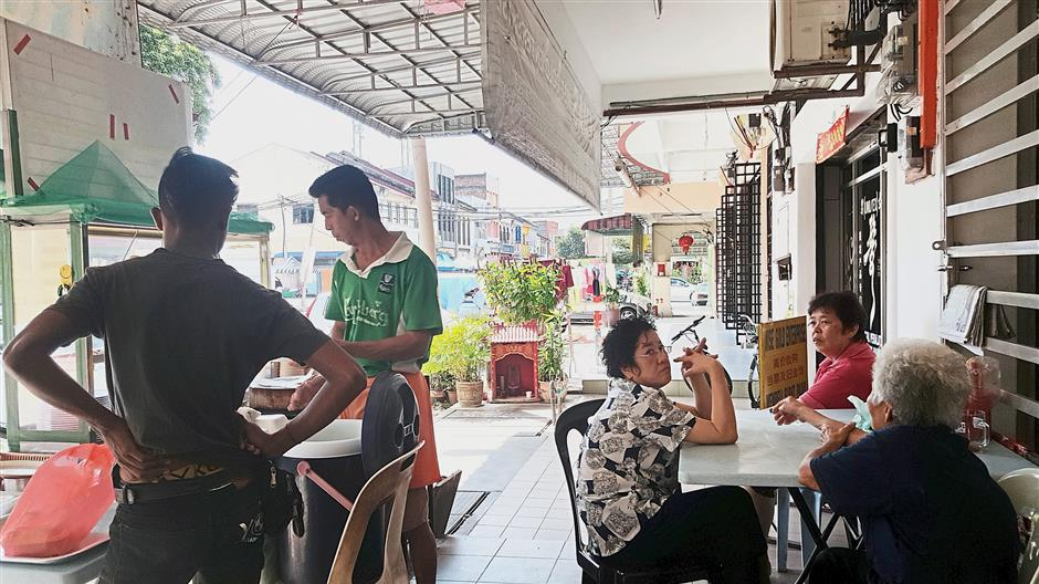Kampung Baru Tanjung Rambutan's ageing residents like to meet up at a local coffeeshop.