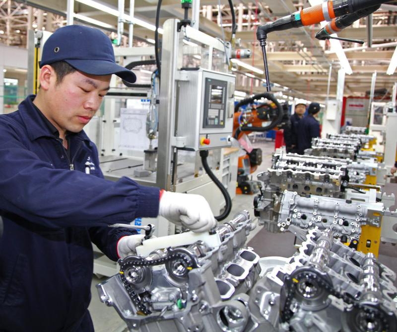 An employee working at Daimler\'s new engine plant in Beijing, China. Chinese industrial firms\' profits rose 6% in December to 942.5 billion yuan (US$155.84bil).
