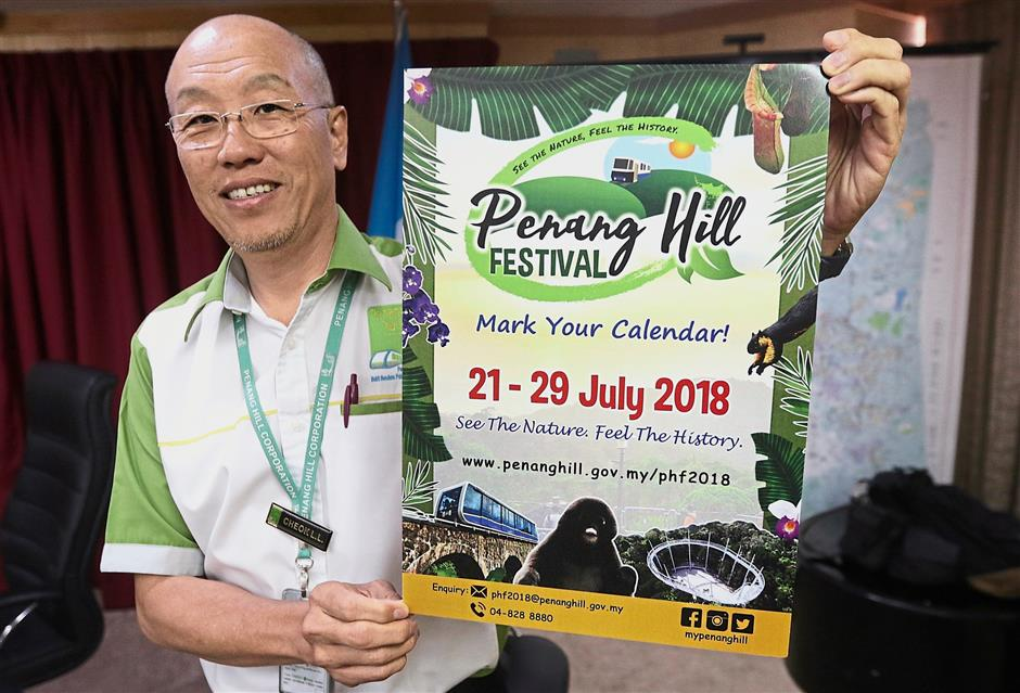 Penang Hill Corporation general manager Cheok Lay Leng showing the Penang Hill Festival 2018 poster at a press conference.