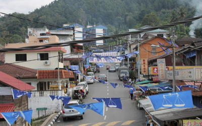 Hill town: One of the 15 Chinese new villages in Bentong - Kampung Baru Bukit Tinggi - decorated with flags due to the imminent general election.