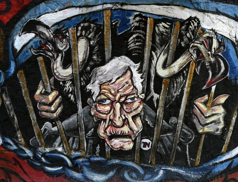 A grafitti depicting US Judge Thomas Griesa and the corporate vultures behind bars in Beunos Aires. Judge Griesa, who recently held that Argentina was in contempt u2013 and presumably liable to be locked up until sufficiently penitent u2013 is not the most popular man in Argentina today u2013 AFP Photo.