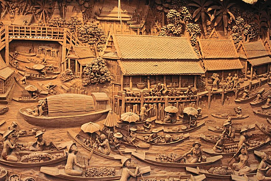 Carvings on teak wood in Baan Tawai, usually tell stories of the Lanna way of life hundreds of years ago.