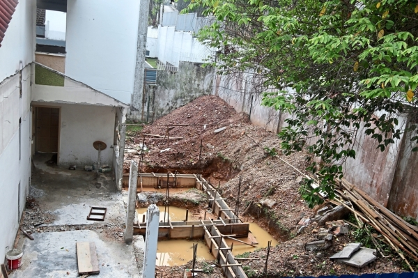Neighbouring houseowners worry this abandoned construction site  could become a breeding ground for Aedes mosquitoes.