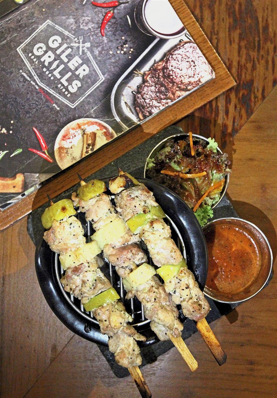 For skewered meats, Giler Grills offers both charcoal pit versions and flaming versions. Seen here is the Apple Chicken charcoal pit skewer.