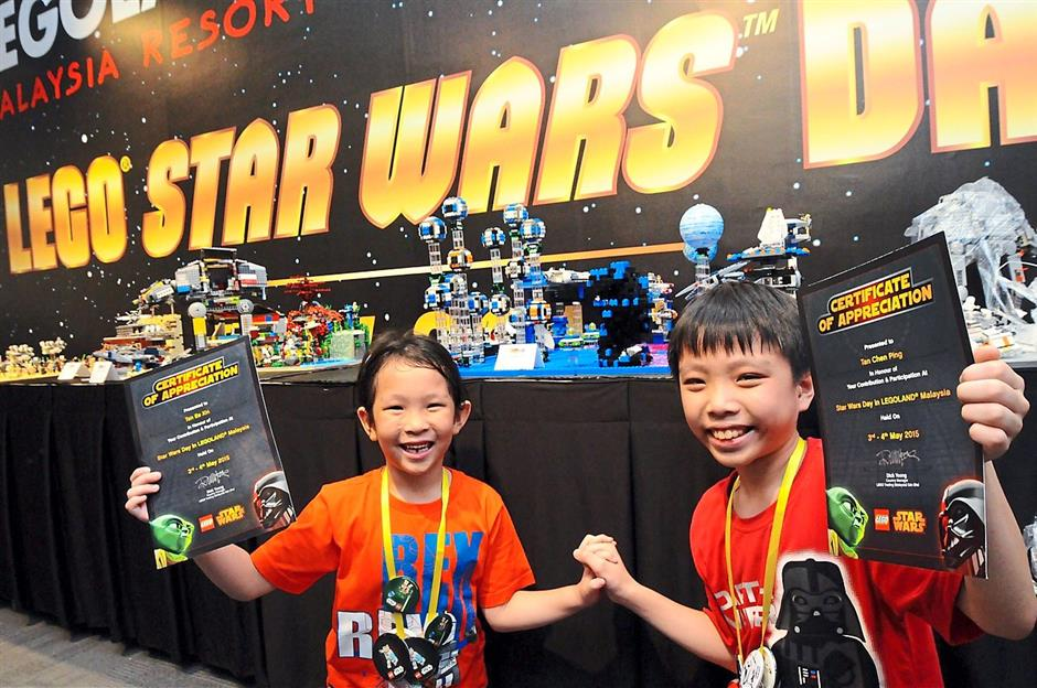 Pint-sized powerhouse: Ee Xin and Chen Ping showing their certificates for the Lego My Own Creation competition.