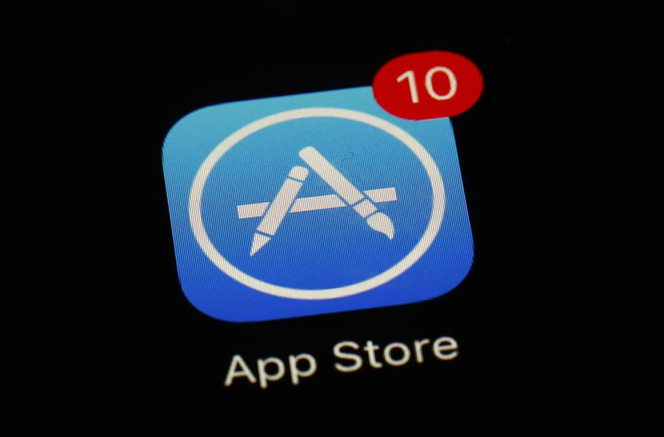 FILE - This March 19, 2018 file photo shows Apple\'s App Store app in Baltimore. Since its debut 10 years ago Tuesday, July 10, 2018, Appleu2019s app store has unleashed new ways for us to work, play, and become lost in our screens. (AP Photo/Patrick Semansky, File)