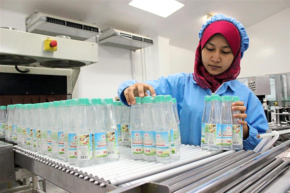 A factory worker inspecting the products before they are packed and shipped off.