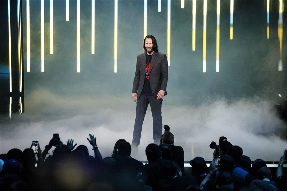 Actor Keanu Reeves of the Cyberpunk 2077 video game stands on stage during of the Microsoft Corp. Xbox event ahead of the E3 Electronic Entertainment Expo in Los Angeles, California, U.S., on Sunday, June 9, 2019. Microsoft introduced its new Xbox console that will be four times more powerful than the current generation Xbox One X, thanks to an AMD processor that allows for 120 frames per second. Photographer: Patrick T. Fallon/Bloomberg