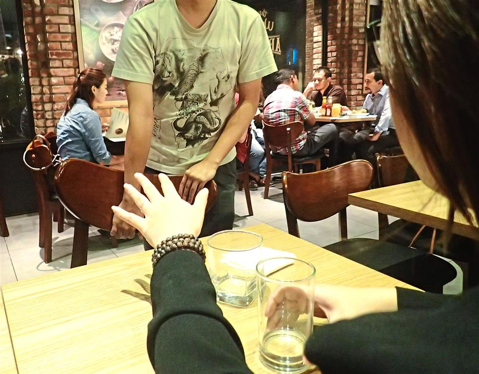 8. Ask before taking a chair at a restaurant