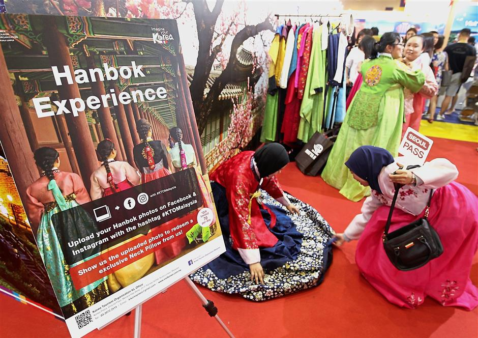 Visitors getting a taste of Korea as the Hanbok is showcased at the fair.