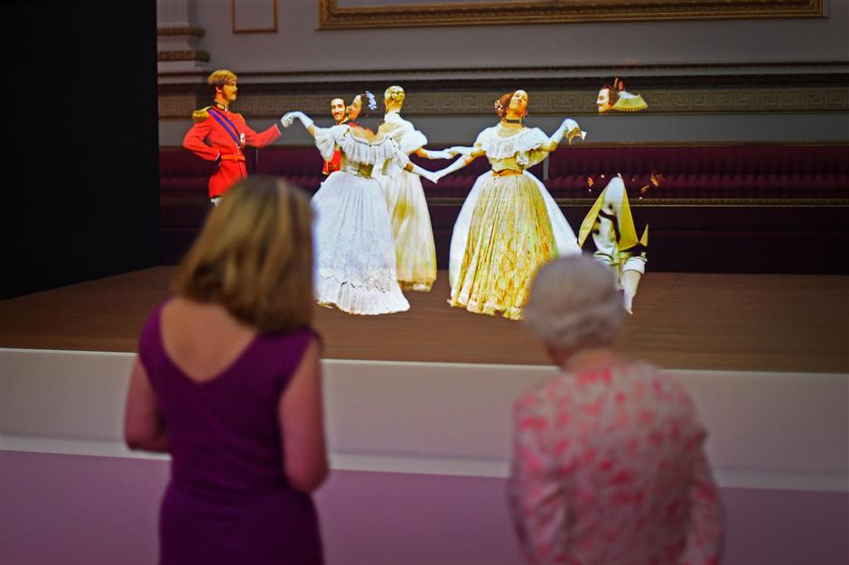REFILE - ADDING BYLINE   Britain's Queen Elizabeth II looks at a Victorian illusion technique known as Pepper's Ghost of a waltz danced at the Crimean Ball of 1856, in the Ballroom at Buckingham Palace, as part of the special exhibition celebrating the 200th anniversary of the birth of Queen Victoria which marks this year's Summer Opening of Buckingham Palace in London, Britain, July 17, 2019. Victoria Jones/Pool via REUTERS