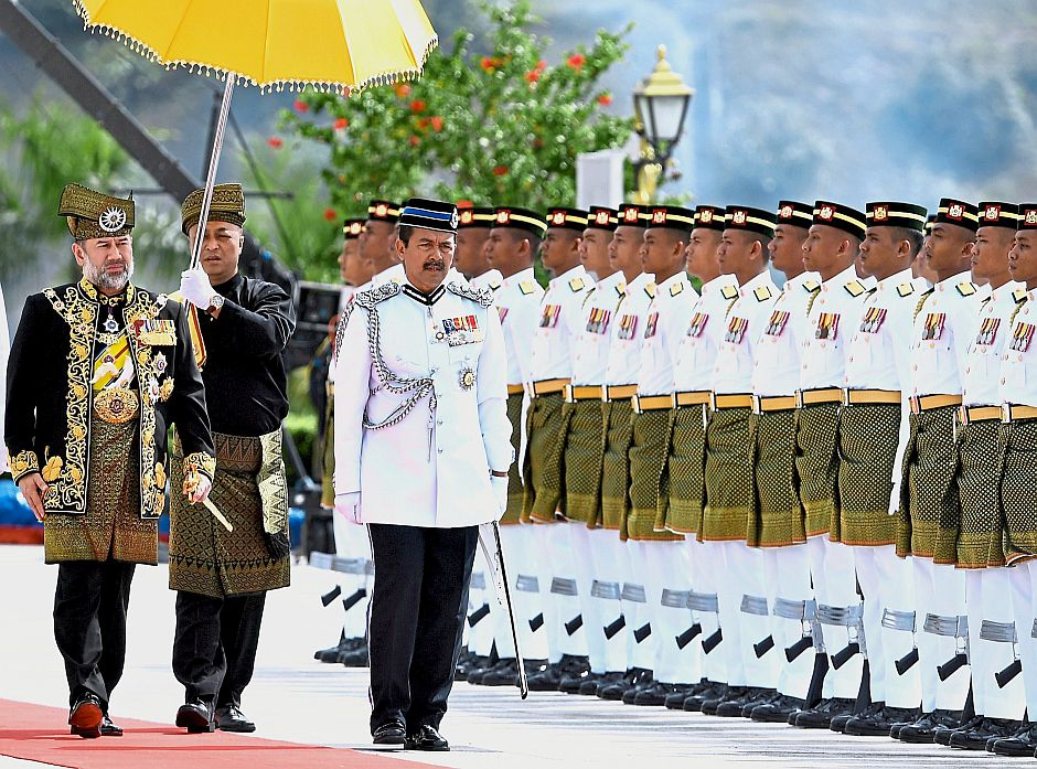 Royal inspection: Sultan Muhammad V inspecting a guard of honour mounted by the 1st Battalion of the Royal Malay Regiment led by Mejar Azlan Shah Baharom in conjunction with his official birthday celebration at Istana Negara in Kuala Lumpur. u2014 Bernama