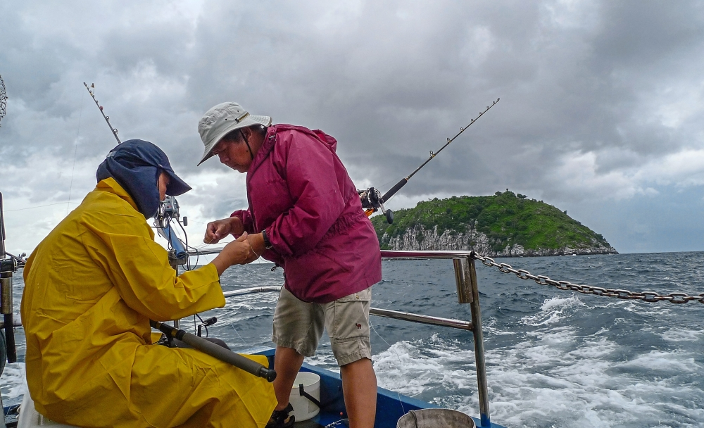 Anglers usually use the trawling method to catch predator fish such as tenggiri. (Inset) Talang or queenfish is a good game fish that can be caught on a light tackle. The species is plentiful off the Penang coast.