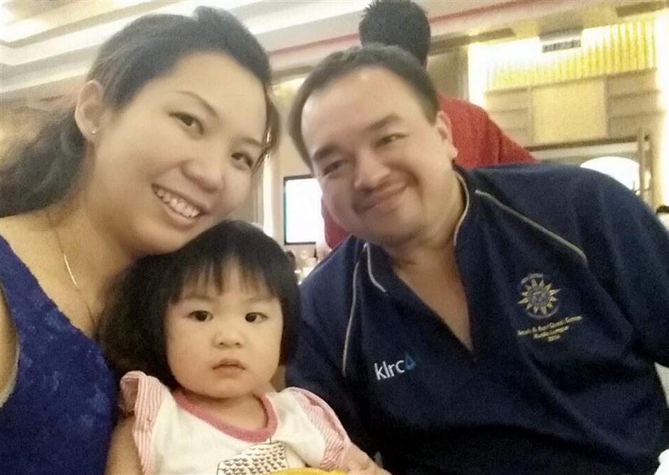 A young family: Lai with wife, Shamaine Chong, 34, and daughter, Erin Lai.