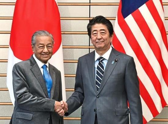 Trading partners: Dr Mahathir meeting Abe in Tokyo during the PMu2019s working visit to Japan. u2014 Bernama