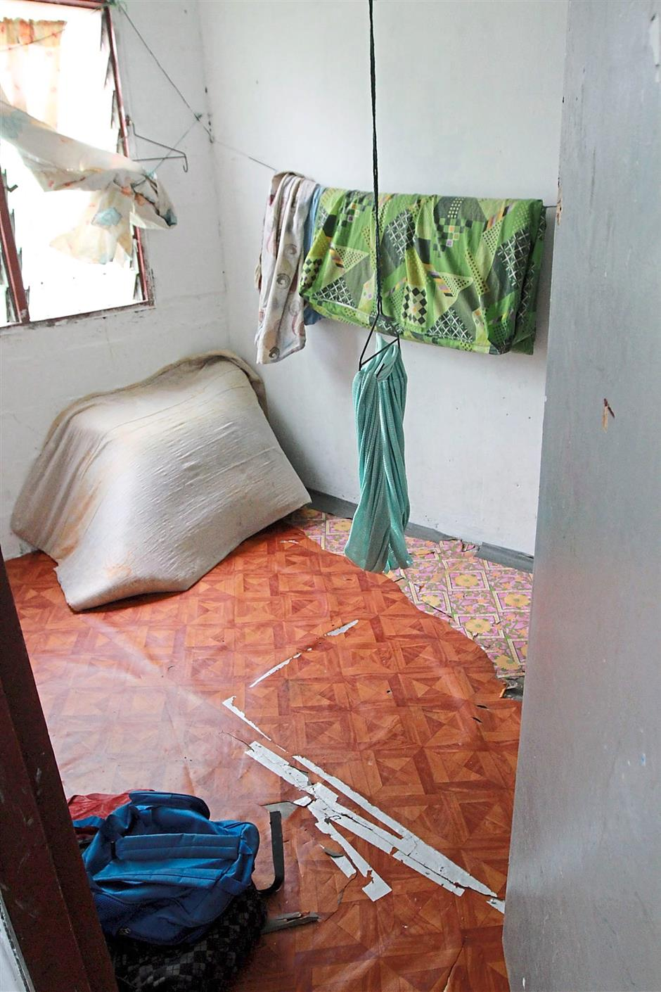 Stripped to the basics: A bare low-cost flat unit occupied by Myanmarese refugee. Mattresses and mats were provided by donors. Such a unit is often taken up two or three families.
