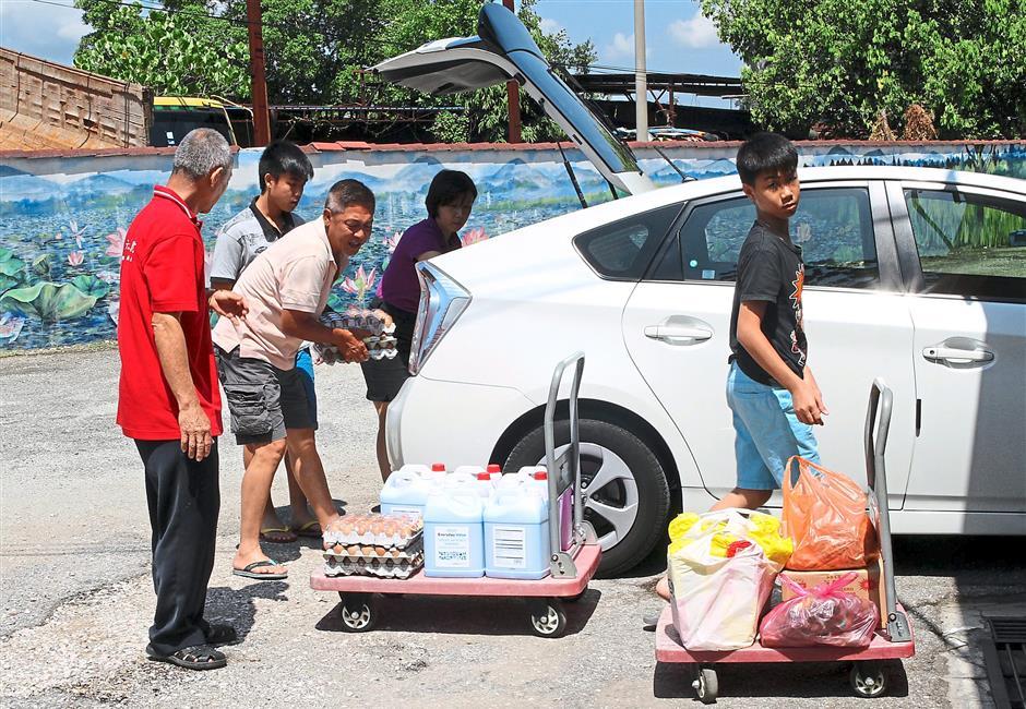 Arrival of the goods: A family bringing in their contribution of essential items to Persatuan Kebajikan Warga Tua Seri Bahagia Ipoh.