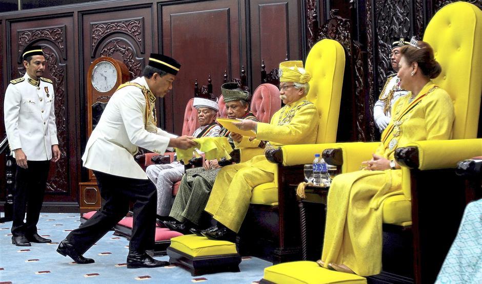 Negri Sembilan Mentri Besar Datuk Seri Mohamad Hasan presenting the Royal address to Tuanku Muhriz at the opening of the state assembly sitting last April. Also present was ?Tuanku Aishah Rohani (right). — UU BAN/The Star