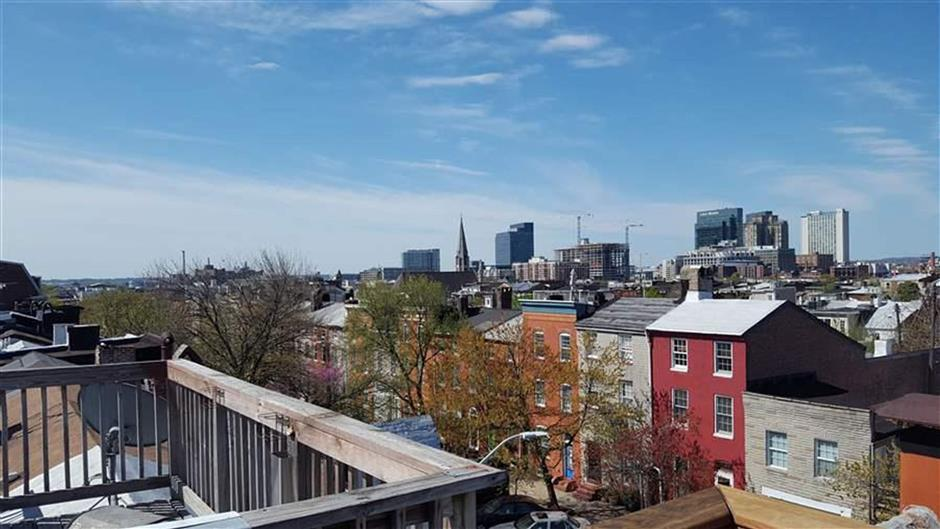 The view of downtown Baltimore from the roof of Jeannette Belliveau's historic townhouse, which she rents to short-term guests. (The Pew Charitable Trusts)