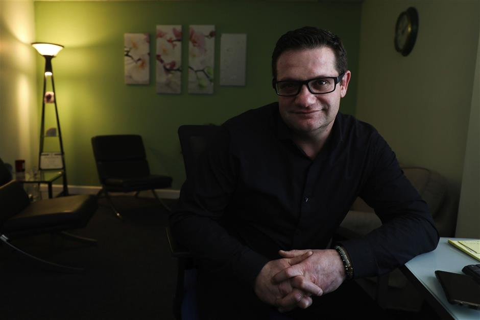 Lucien Izraylov, an addiction counselor and former heroin user, in his office in Evanston, Thursday Feb. 21, 2019.  He has created a smartphone app that will connect drug users with volunteers who will make sure they don\'t overdose.   (Abel Uribe/Chicago Tribune/TNS)