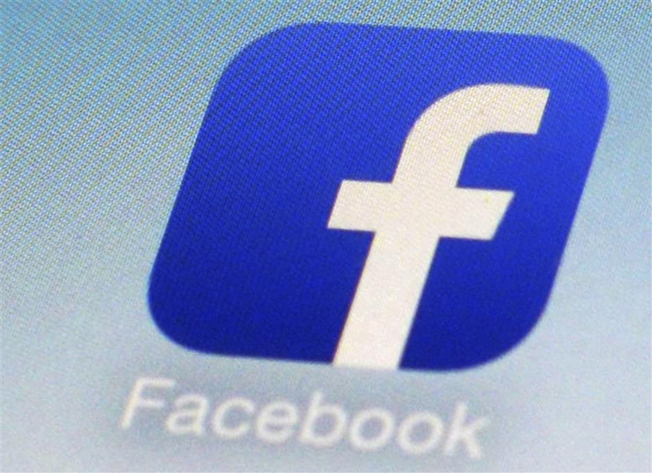 FILE - This Feb. 19, 2014, file photo, shows a Facebook app icon on a smartphone in New York. The ACLU is accusing Facebook of discrimination, saying the company violated federal and state laws prohibiting businesses from excluding women from job ads. In a complaint filed Tuesday, Sept. 18, 2018, with the Equal Employment Opportunity Commission, the ACLU also lists 10 employers that it claims have placed discriminatory ads. (AP Photo/Patrick Sison, File)