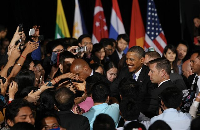 US President Barack Obama having a light moment with the audience upon leaving after attending the YSEALI Town Hall session at Dewan Tunku Canselor (DTC), Universiti Malaya. - IZZRAFIQ ALIAS / The Star