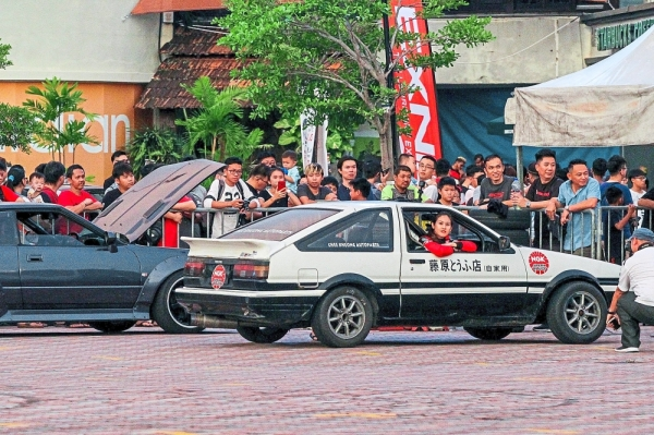 Chin showing off her drifting skills in her race car.